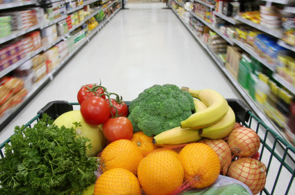 Grocery cart filled with nutritious fruits and vegetables.