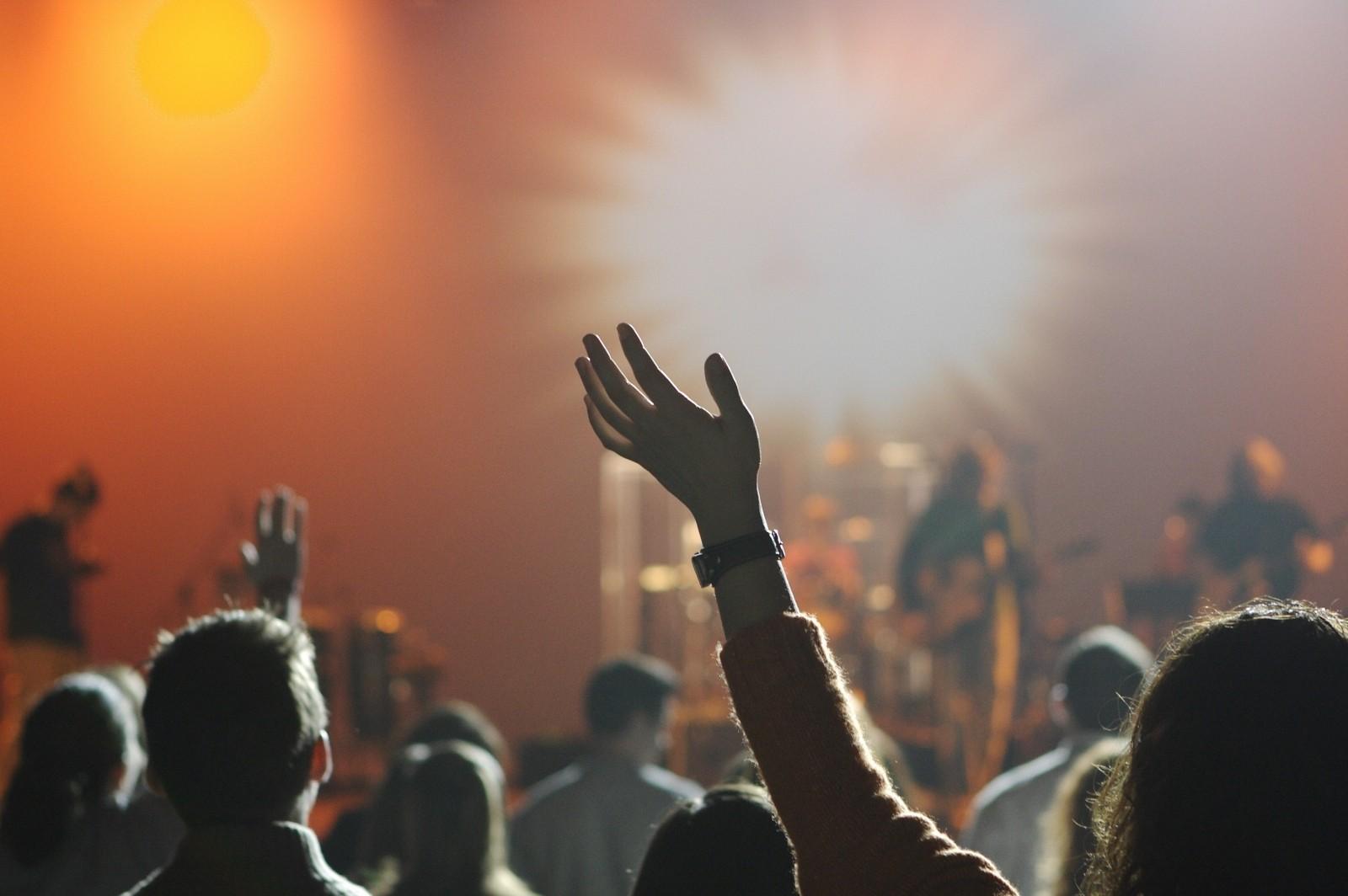 people-enjoying-rock-concert-applauding