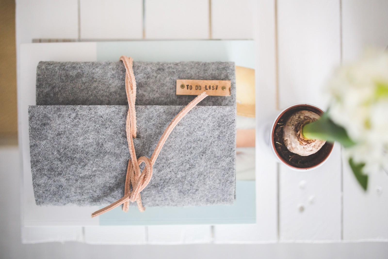 grey-felt-journal-to-do-list-on-a-white-desk